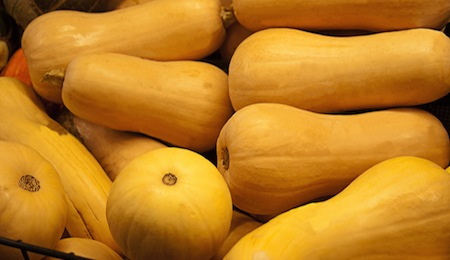 Fresh yellow butternut squash for sale in produce market