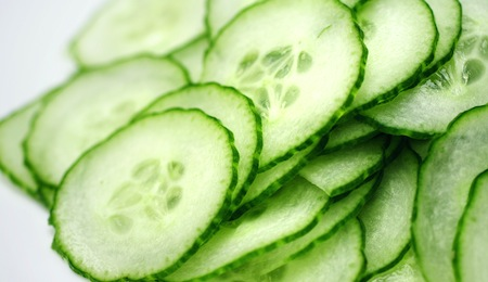 Cucumber slices on white background